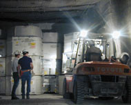 A forklift emplaces waste in the WIPP underground.