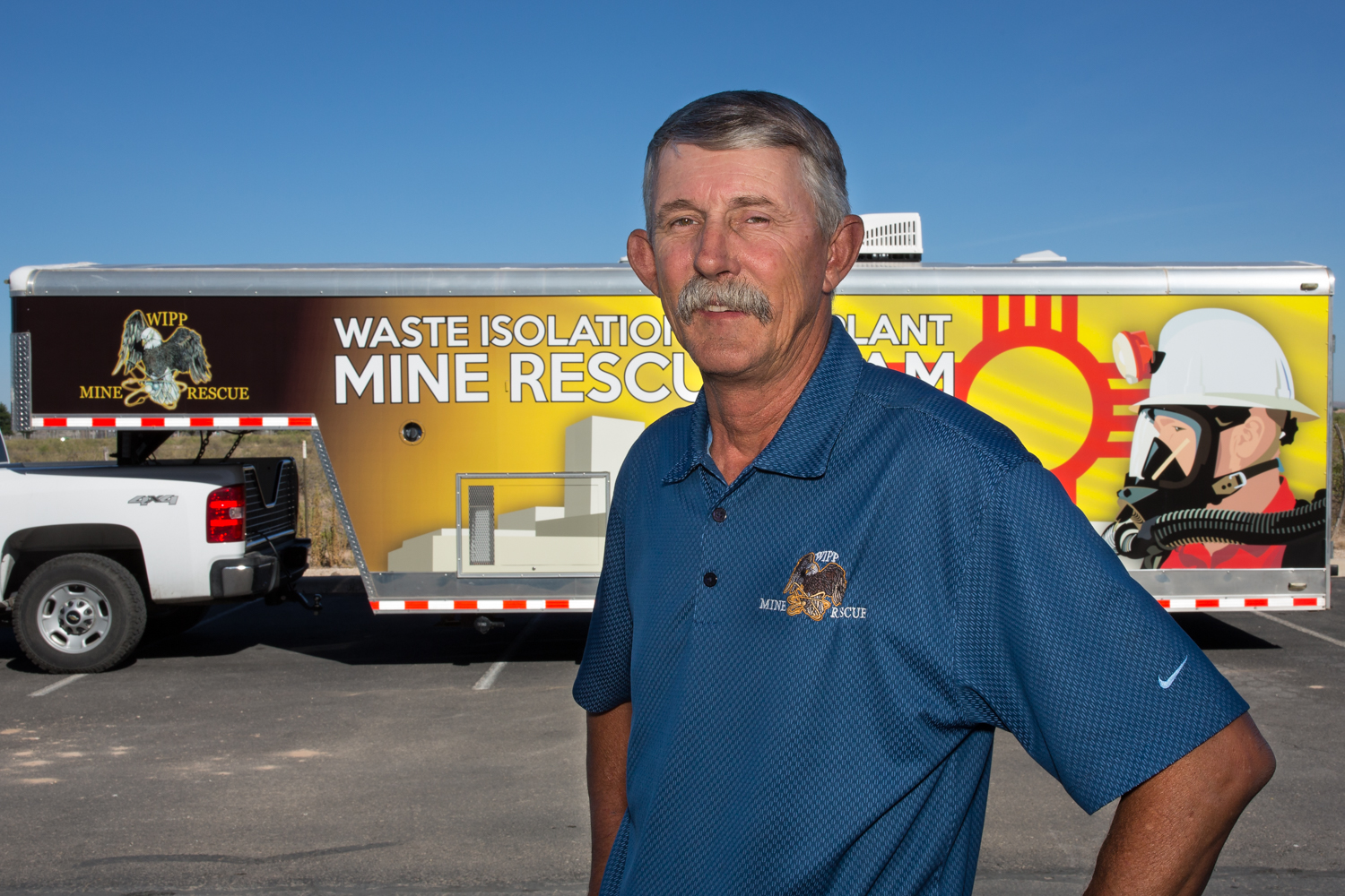 photo of Richard 'Stik' West Standing infront of the WIPP Mine Rescue Truck and Trailer